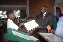 Presenting awards to best students at Kings College Budo 2011