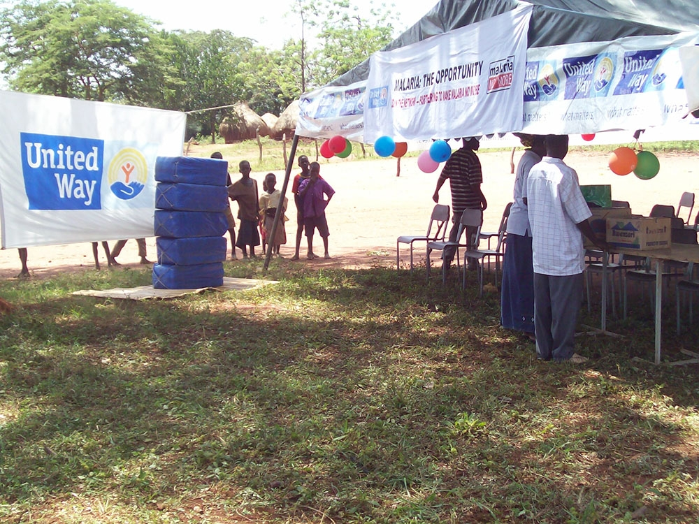 Working with United Way Uganda to distribute free mosquito net in the village of Nabuli eastern Uganda