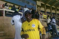 Geoffrey attending football match Uganda v Kenya at Namboole Stadium