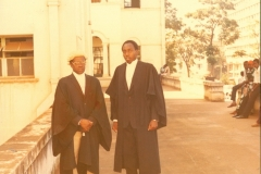 Geoffrey with Yesero Mugenyi on enrolment day at High Court