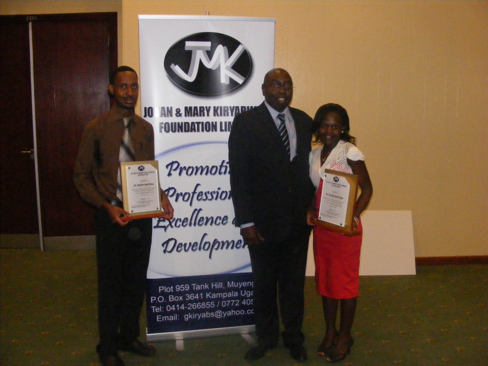 Handing over  JMK awards to Dr Vincent Bakyenga and Dr Phiona Nakyeyune as best interns in neurosurgery 2010 & 2011