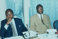 Geoffrey as corporate lawyer presenting paper with Attorney General Bert Katureebe before he became Chief Justice